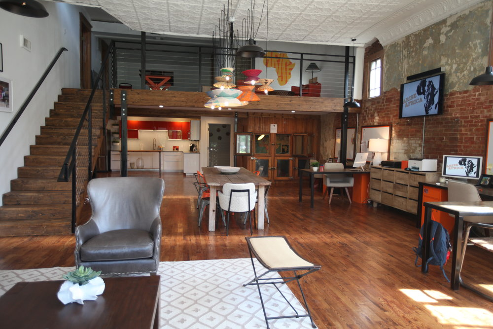 The building had a loft added to it in the 1970's.  The upstairs part of the loft has two bedrooms and a bathroom along with a large sitting area.