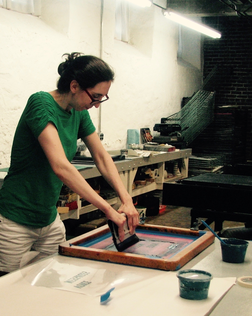 Artist Alice Thompson making the  Voice Messages  screen print poster.