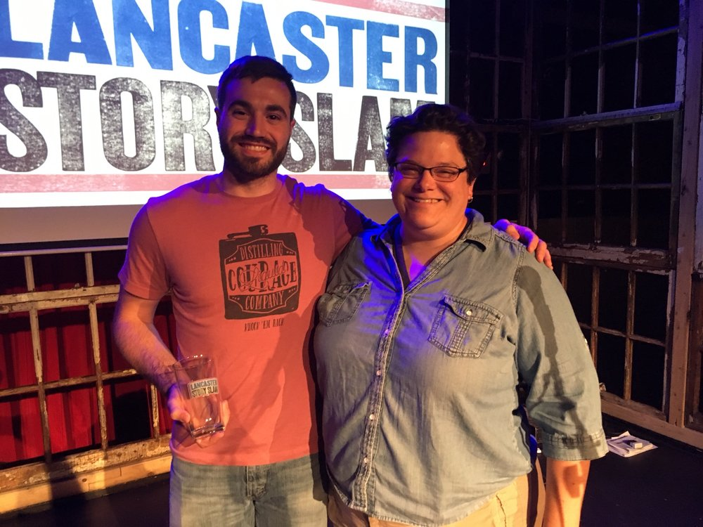 Winner Brian Layng poses with emcee Eileen Joyce