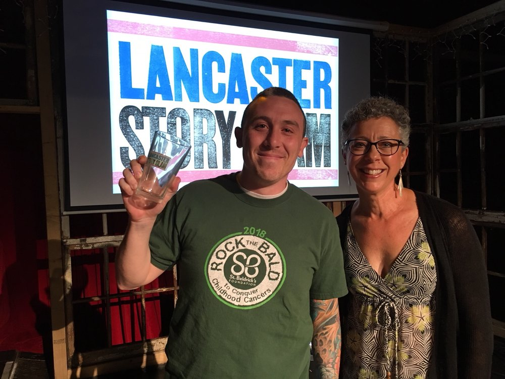 May Story Slam winner Kevin Reinmiller and emcee Melissa Snavely