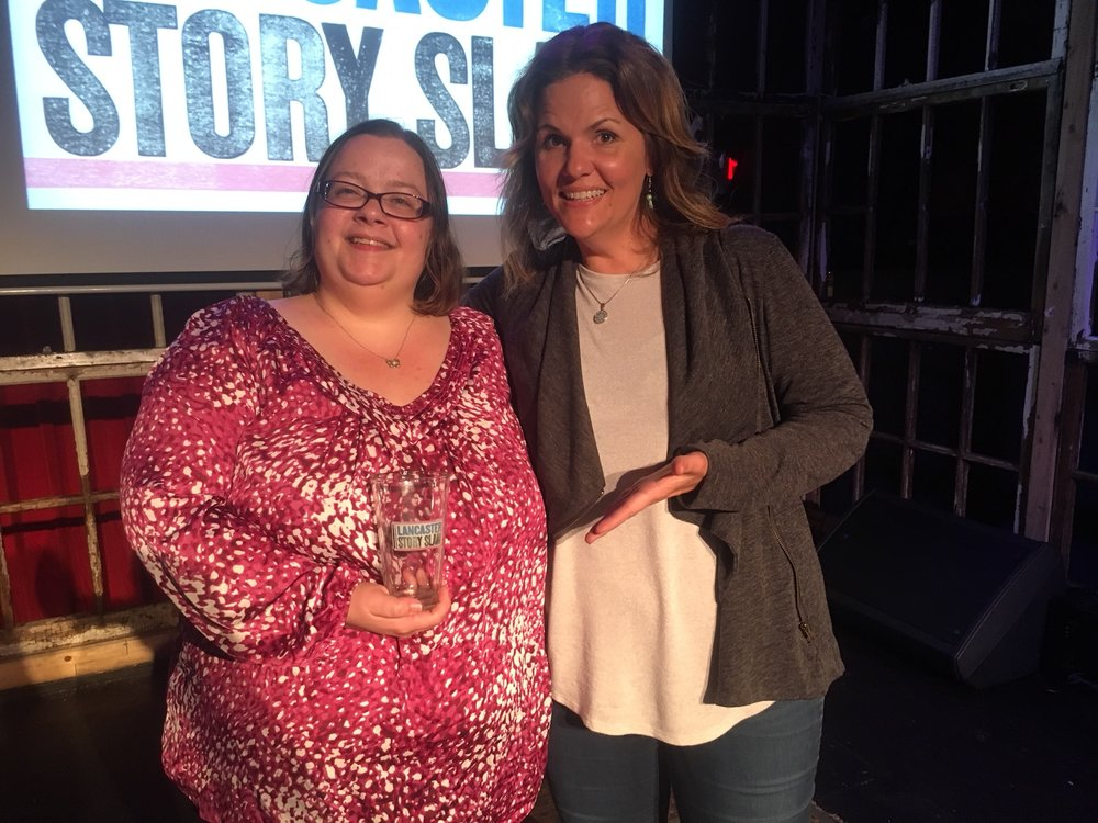 Story Slam winner Mandy Mastros with emcee Luanne Sims.