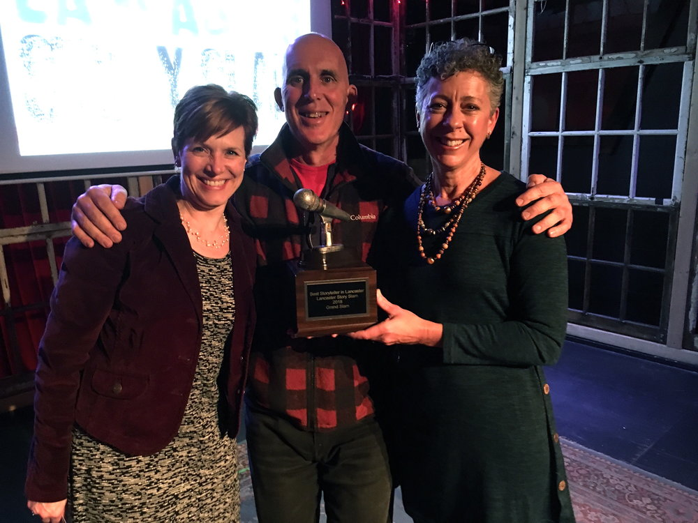 2018 Grand Slam Champion Chris McDougall, Carla Wilson, and emcee Melissa Snavely.