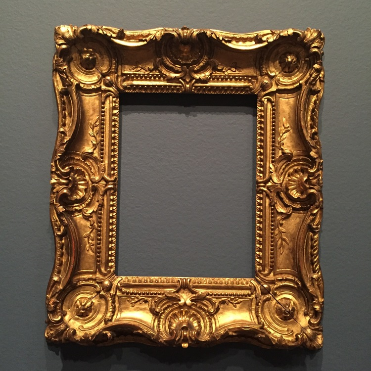 Swept sides and pierced carving are typical of Louis XV frames.