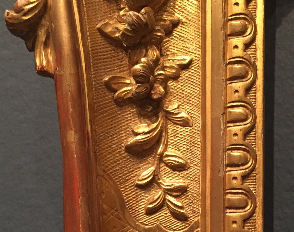 Detail showing surface recutting on an 18th century French Louis XV carved frame.