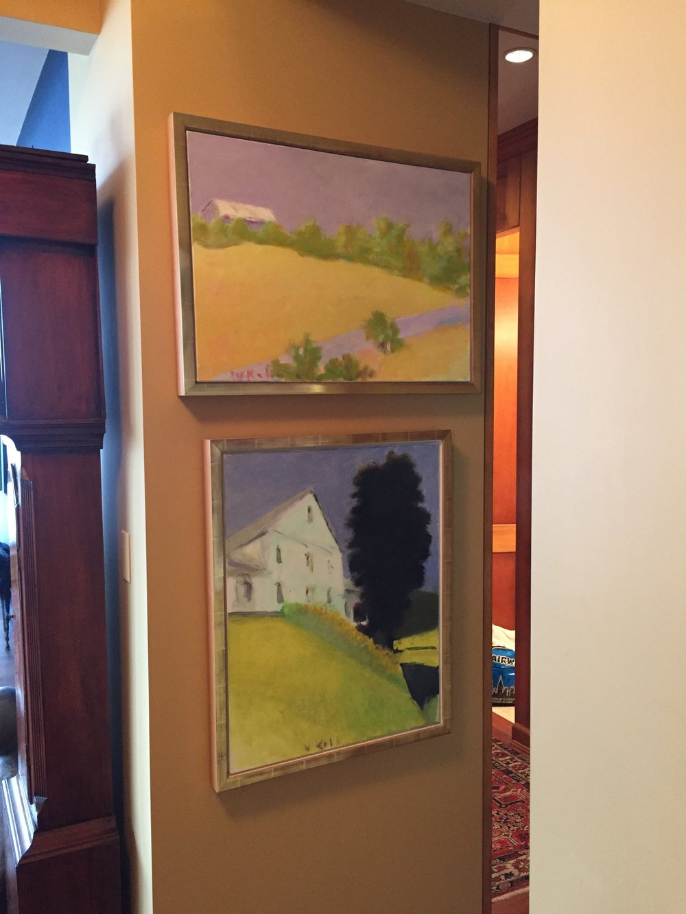 Two o/c paintings by Wolf Kahn in foyer area
