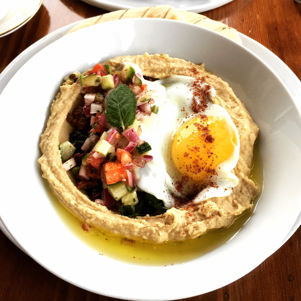 Hummus with spiced lamb, raisins, and fried egg