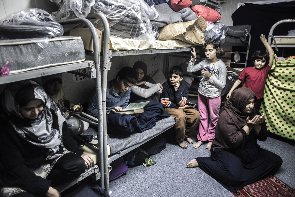 After the Taliban killed 8 of their family members in Pakistan, they decided it was time to leave the country and head off to Europe. Highly educated as they are, they have been inside this container for around 9 months already. Their children haven't gotten any education for 2 years. They speak fluent English.