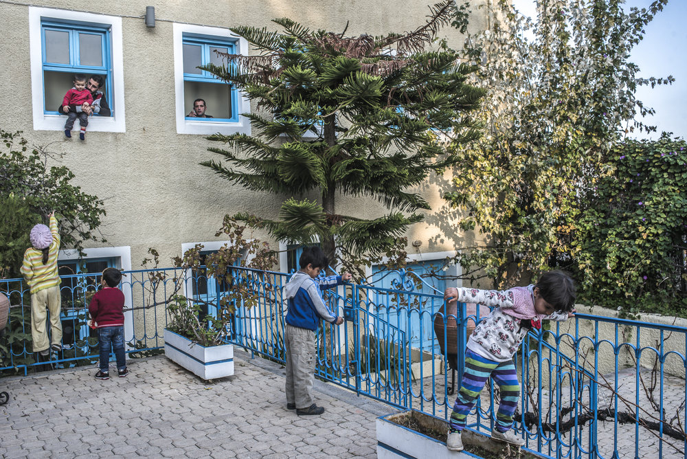 Refugee children playing in hotel in Chios.jpg