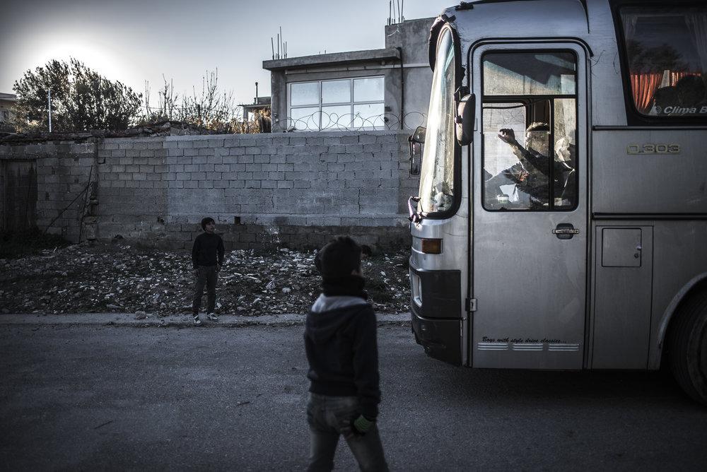 UN bus Souda Camp.jpg