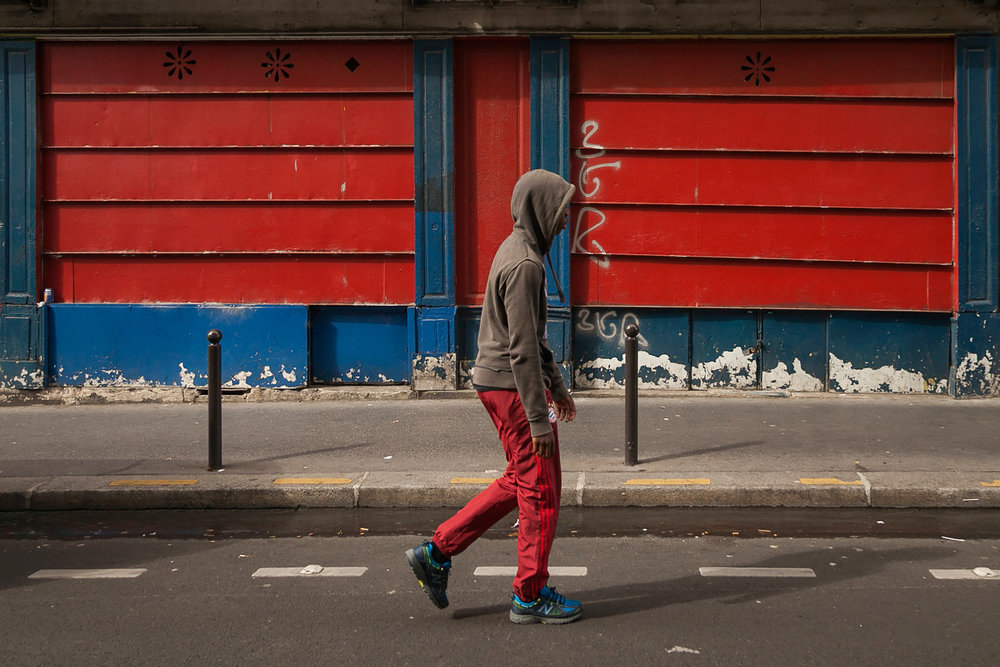 Youngster walks down Rue de Tombouctou.