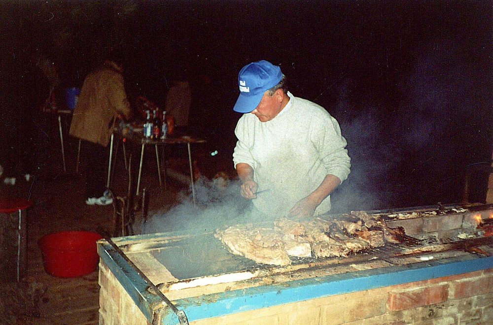 Buryat dishes are mostly based on meat. Masha's father grilling meat. Photo from a family archive.