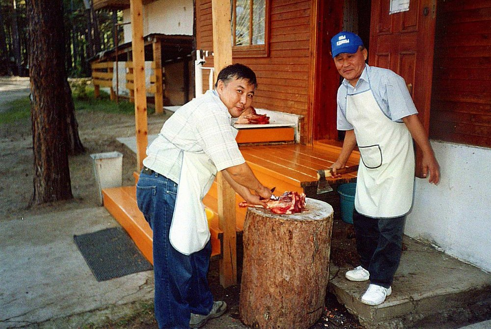 Dressing the meat. Photo from a family archive.