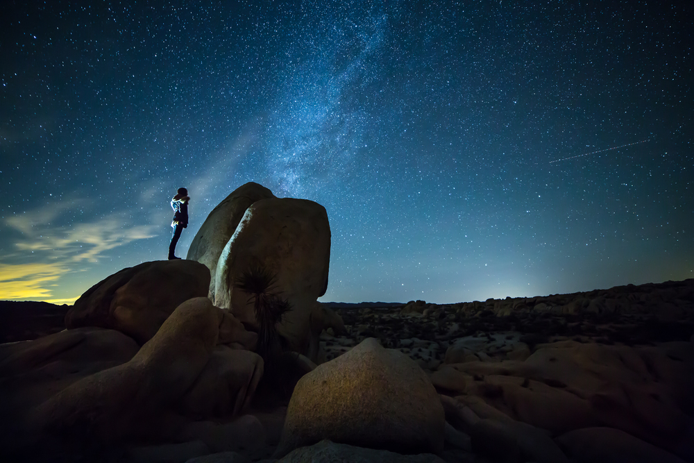 CANDY LOOKING UP AT THE MILKY WAY (AND A SHOOTING STAR!) BY ARCH ROCK.