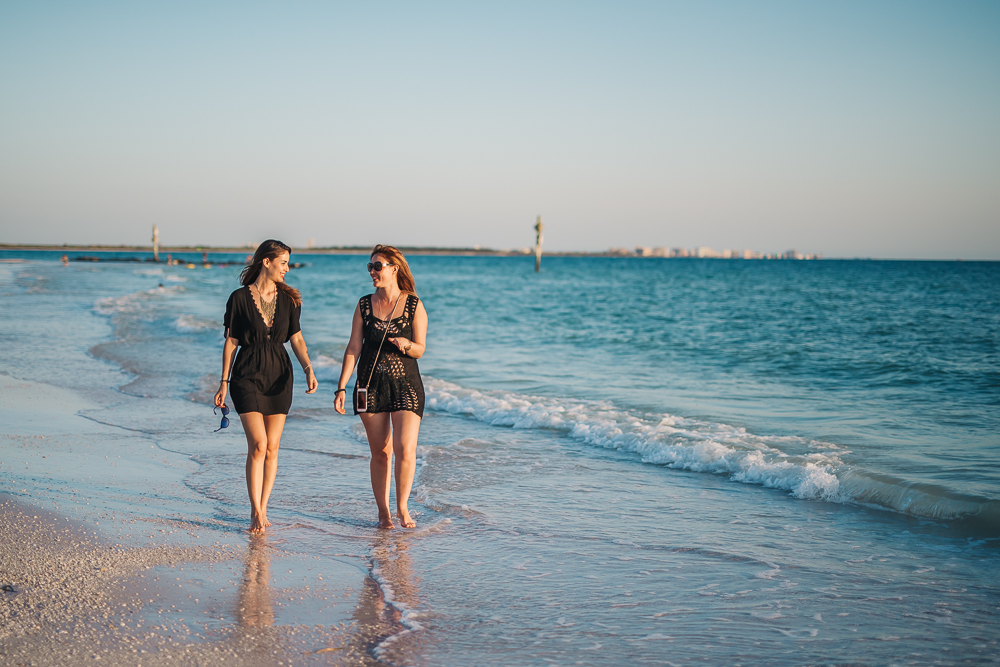 Some girl talk on the beach // Photo by Ryan Sebastyan