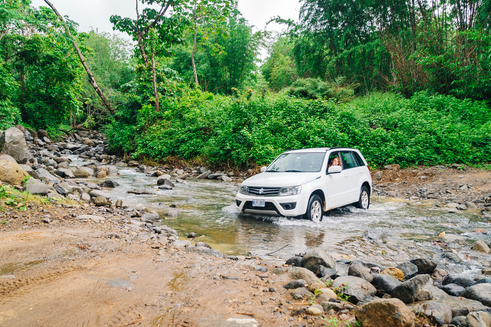 Crystal driving through the river on our way to the waterfall. What a pro!