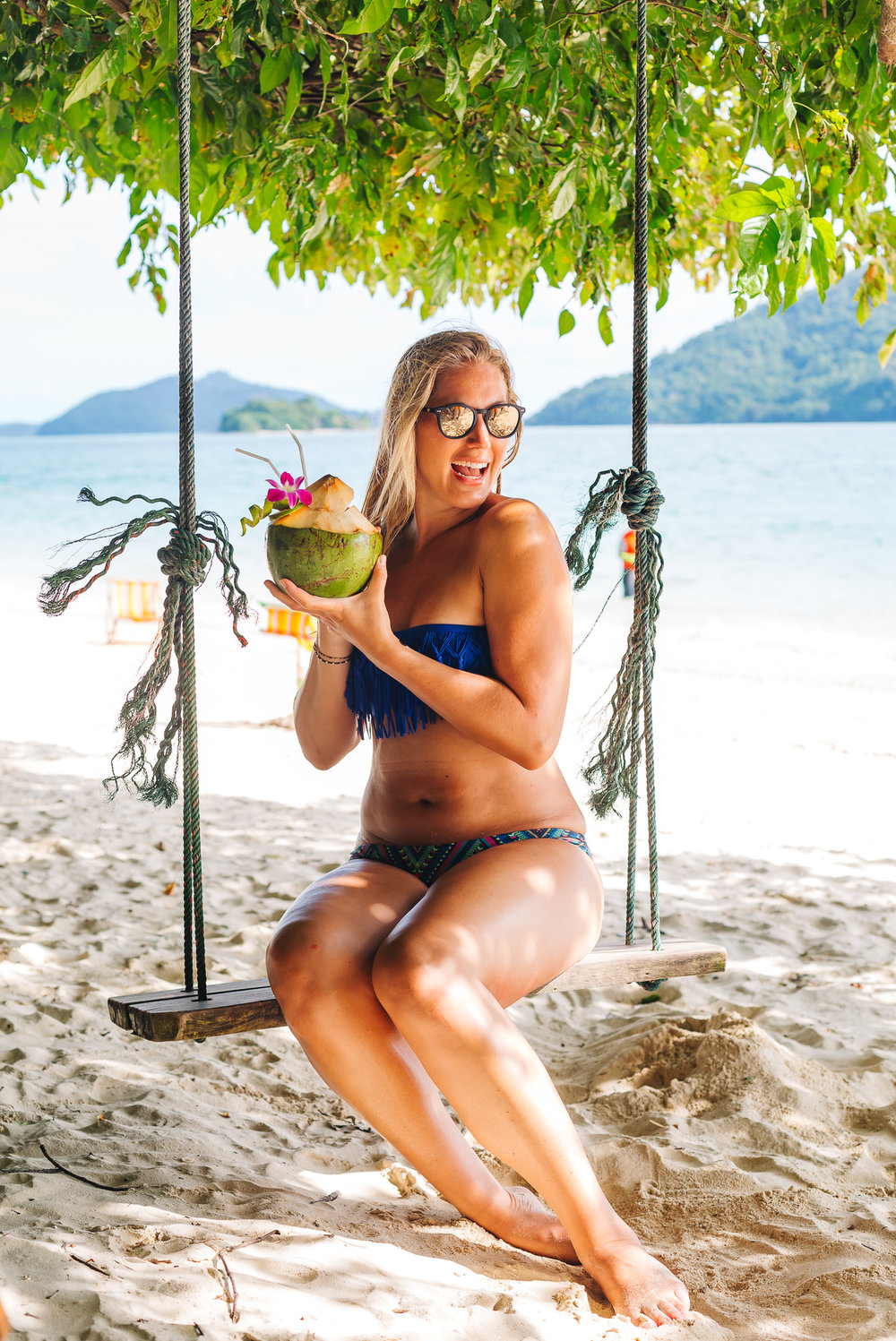 Island hopping isn't complete without a coconut drink