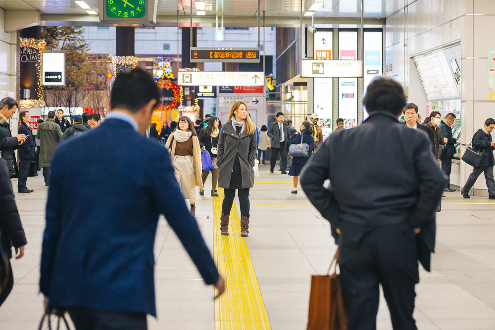 Crystal finding her way through the train station in Tokyo, Japan.