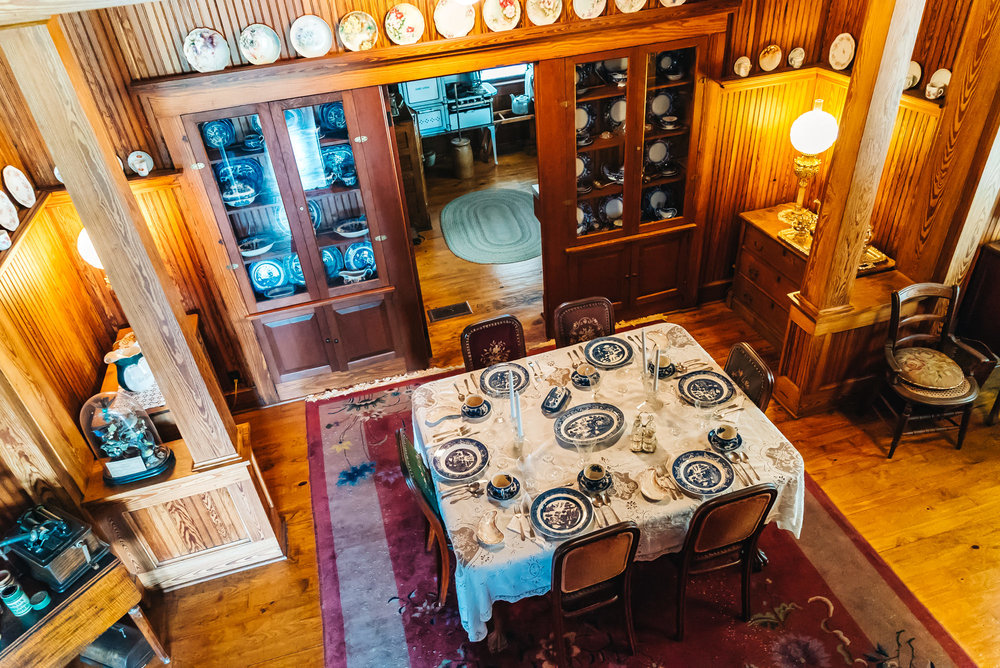 A VIEW OF THE DINING ROOM FROM UPSTAIRS