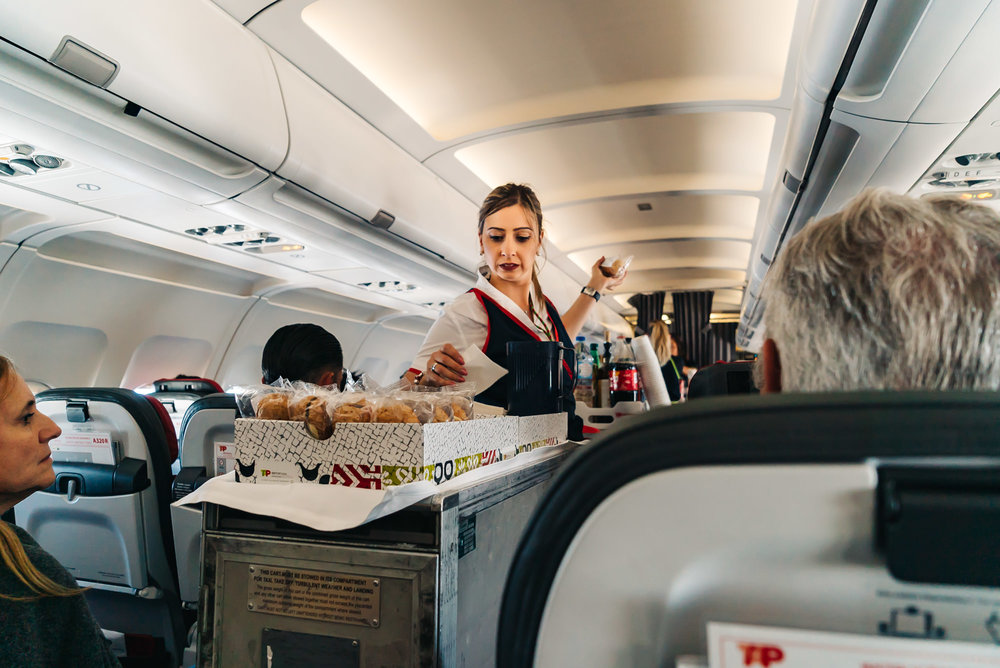Lovely flight attendants serving us complimentary food and drinks