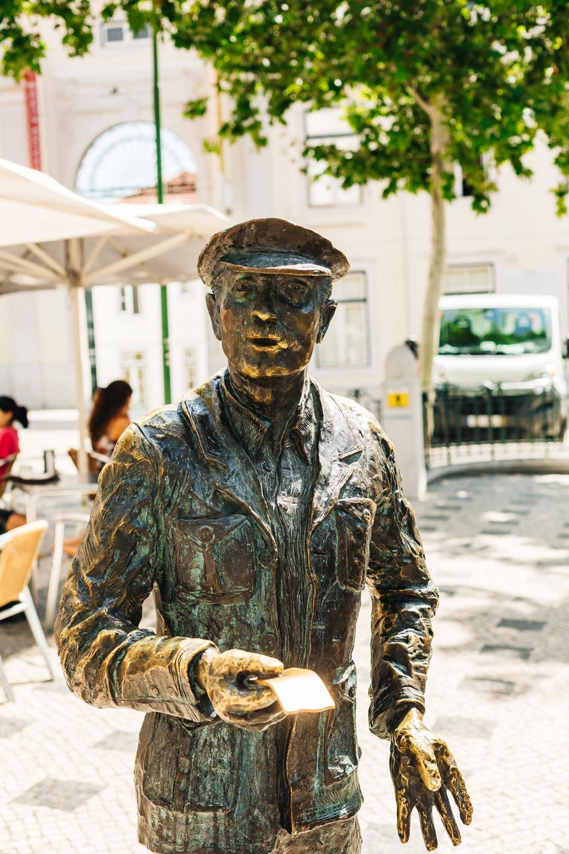 O Cauteleiro Statue in Lisbon, Portugal