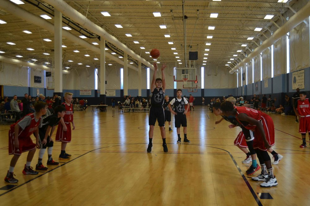 14U Team captain Steinar Christianson hits a huge free throw against fellow Adidas Club, California's GamePoint. (12/16)