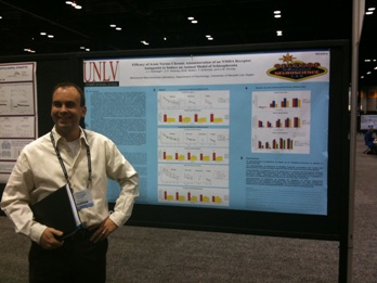 Dr. Kinney smiles in front of his first SfN poster as Principle Investigator.