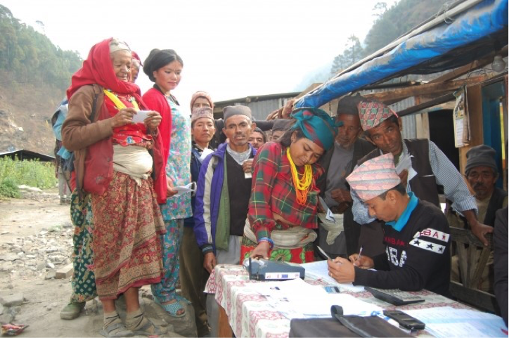 Locals wait in line to register for the first round of government funds. Photo Credit: World Bank
