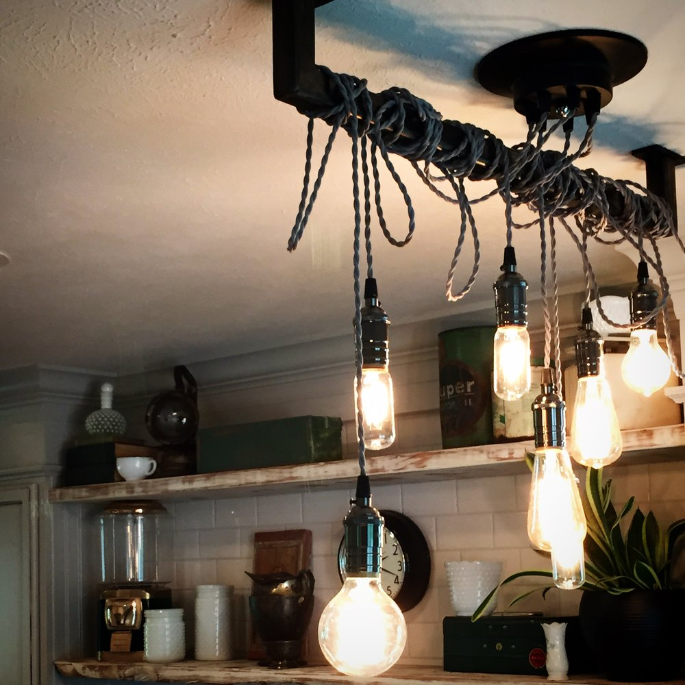 Custom made pendant light for the kitchen island - adds the perfect touch of industrial modern flair.
