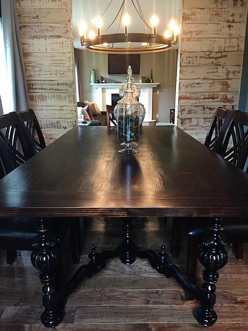 After - Here Cody created a custom dining table, handmade chandelier. The contrast of a vintage farm wood top against the antique table base creates the perfect amount of contrast against the industrial chandelier and shiplap wall.
