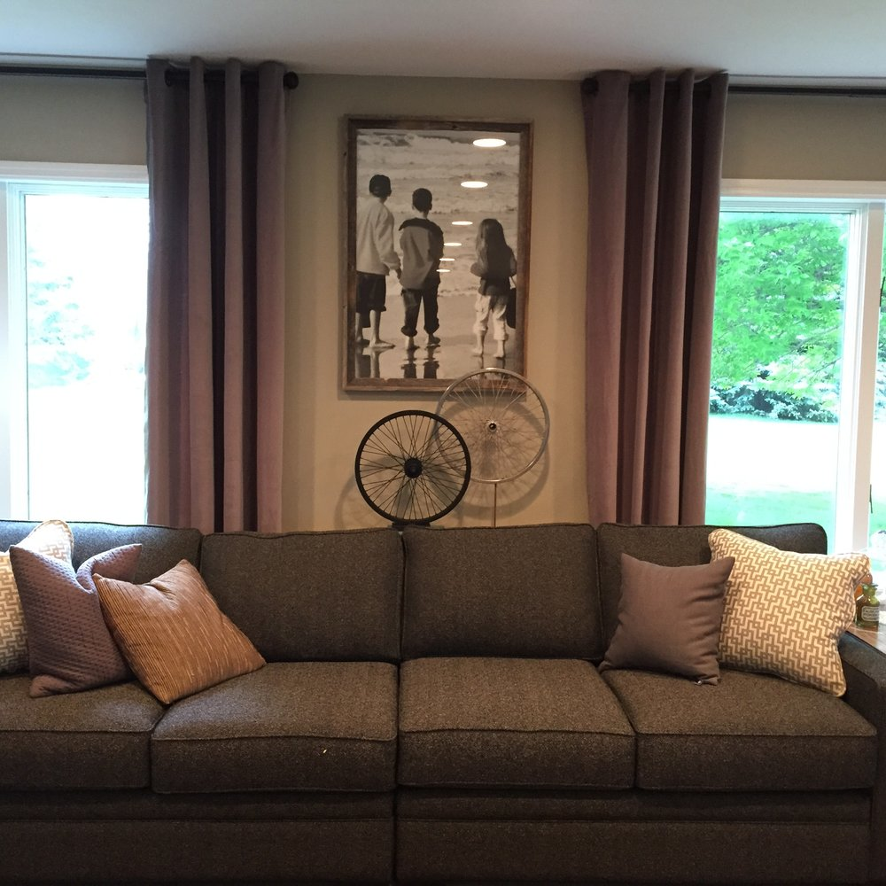 After - Here Cody not only opened up the space to feel bright and airy but he also created artwork of the clients children from years ago.