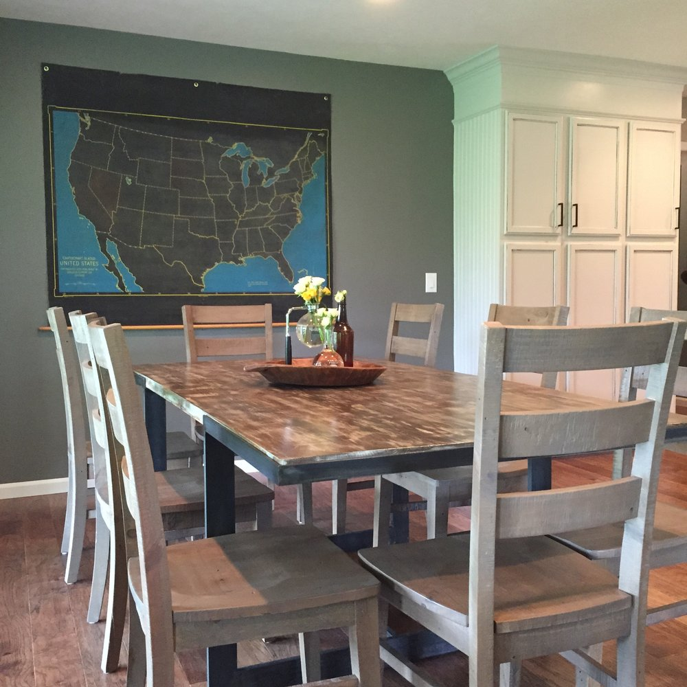 Here Cody and his team paired a vintage map of the US (paying homage to the clients roots as a teacher) with a custom metal and reclaimed wood table he created.