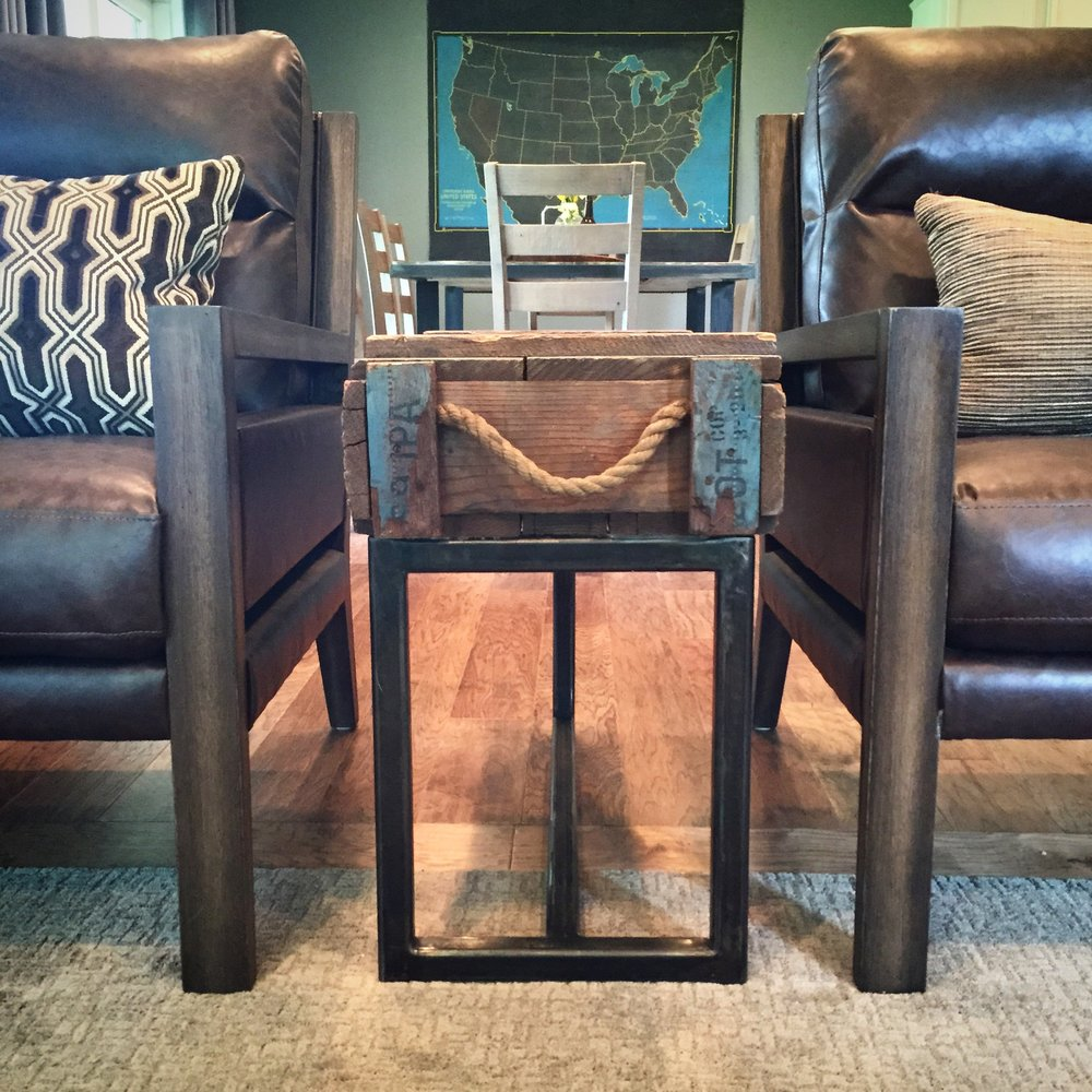 Modern leather chairs paired with this custom military box Cody made into a side table, creates the perfect eclectic mix that represents our clients.