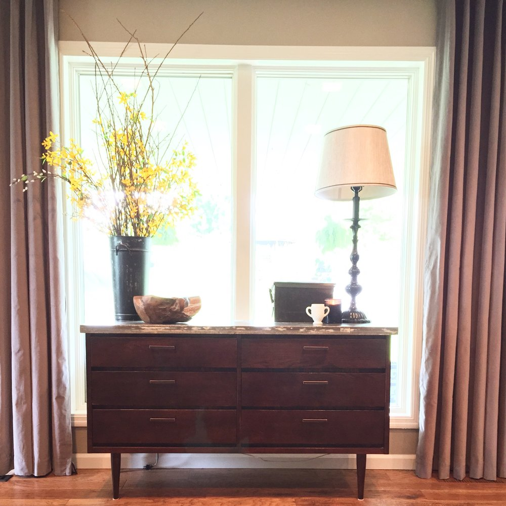 Here Cody refurbished an old Mid Century Modern dresser into the perfect side board to hold all the TV equipment. Adored with a custom stained cement top, this is the perfect addition to the space.