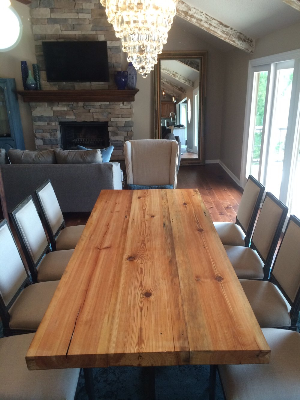 This industrial table Cody created, paired with the traditional/modern chairs creates the perfect gathering space.
