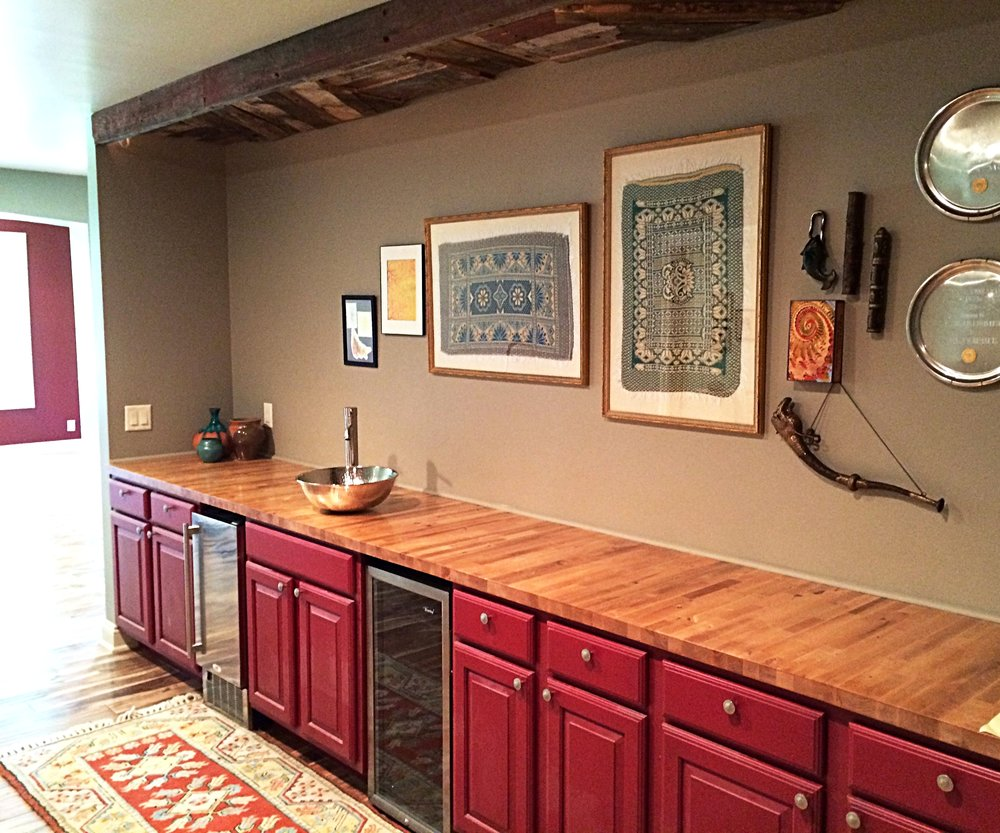 After- Bar Area. Doesn't every bar area need red cabinets with a custom butcher block top and barn wood ceiling detail?!