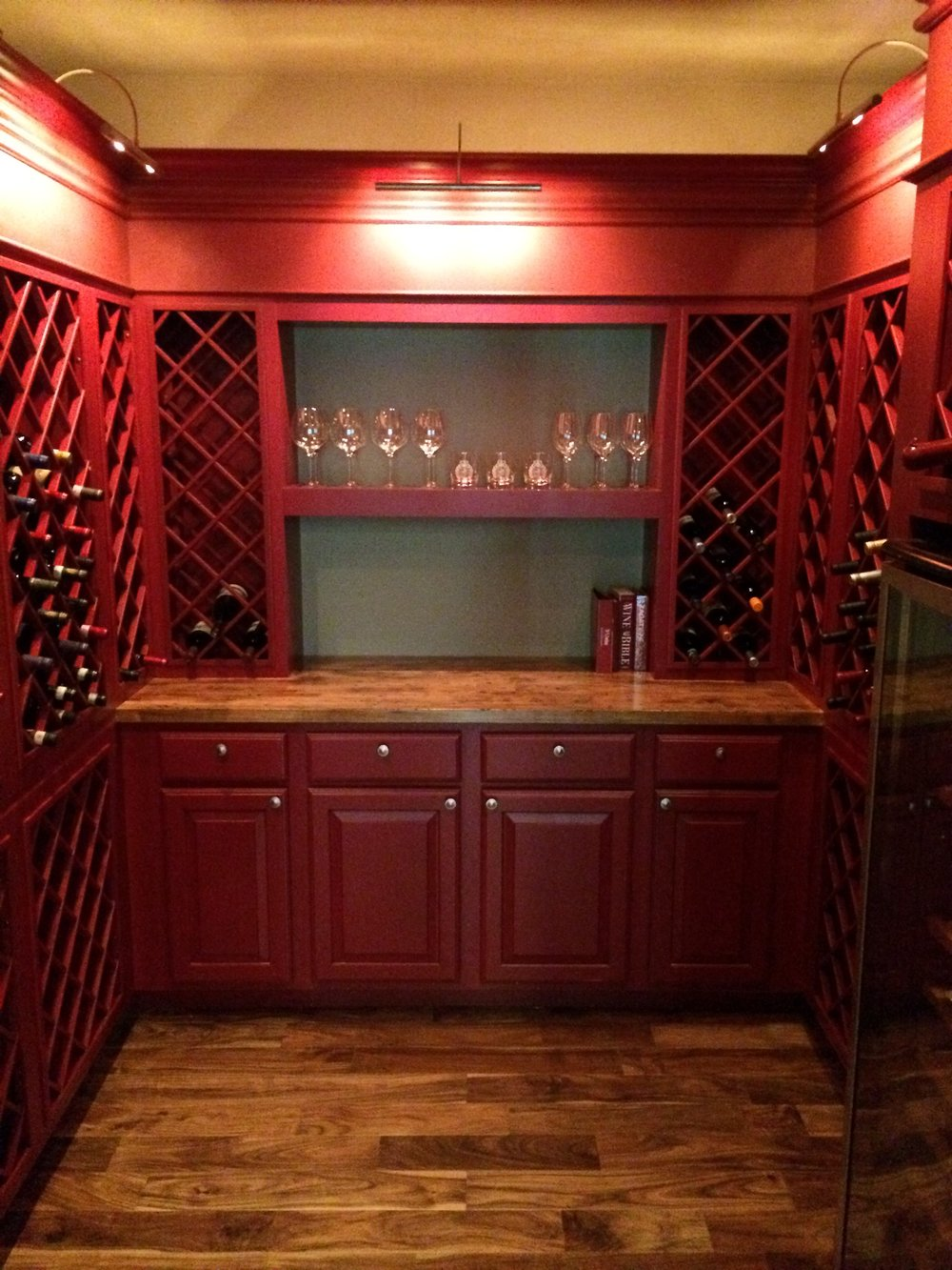 Wine Cellar turned out truly amazing. Room for a wine fridge, pouring and prep area and plenty of storage! Time to get filling it up! LED library lights keep the temps cool while patrons make their wine selections and automatically shut off when leaving the room.