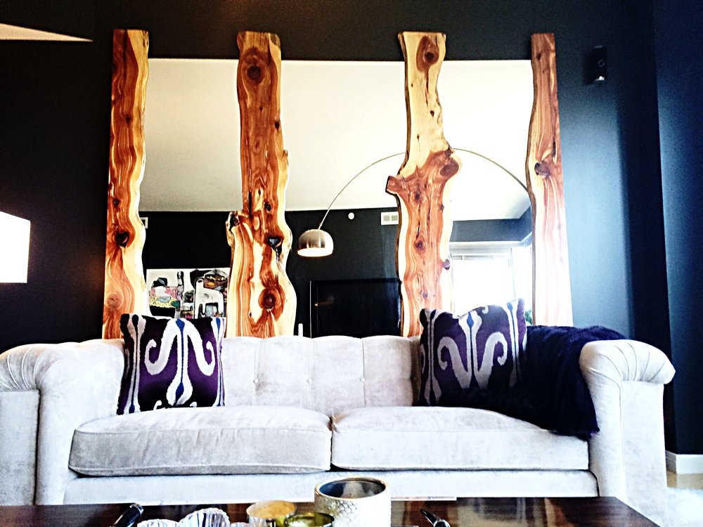 The mirrors almost appear to be floating between the live edge cedar wood.