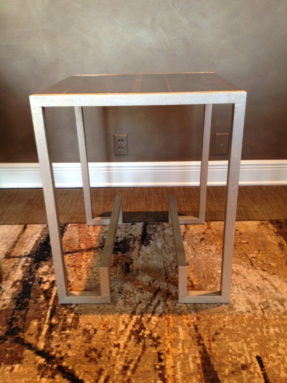 Custom Metal in a pale gold side table Cody created.