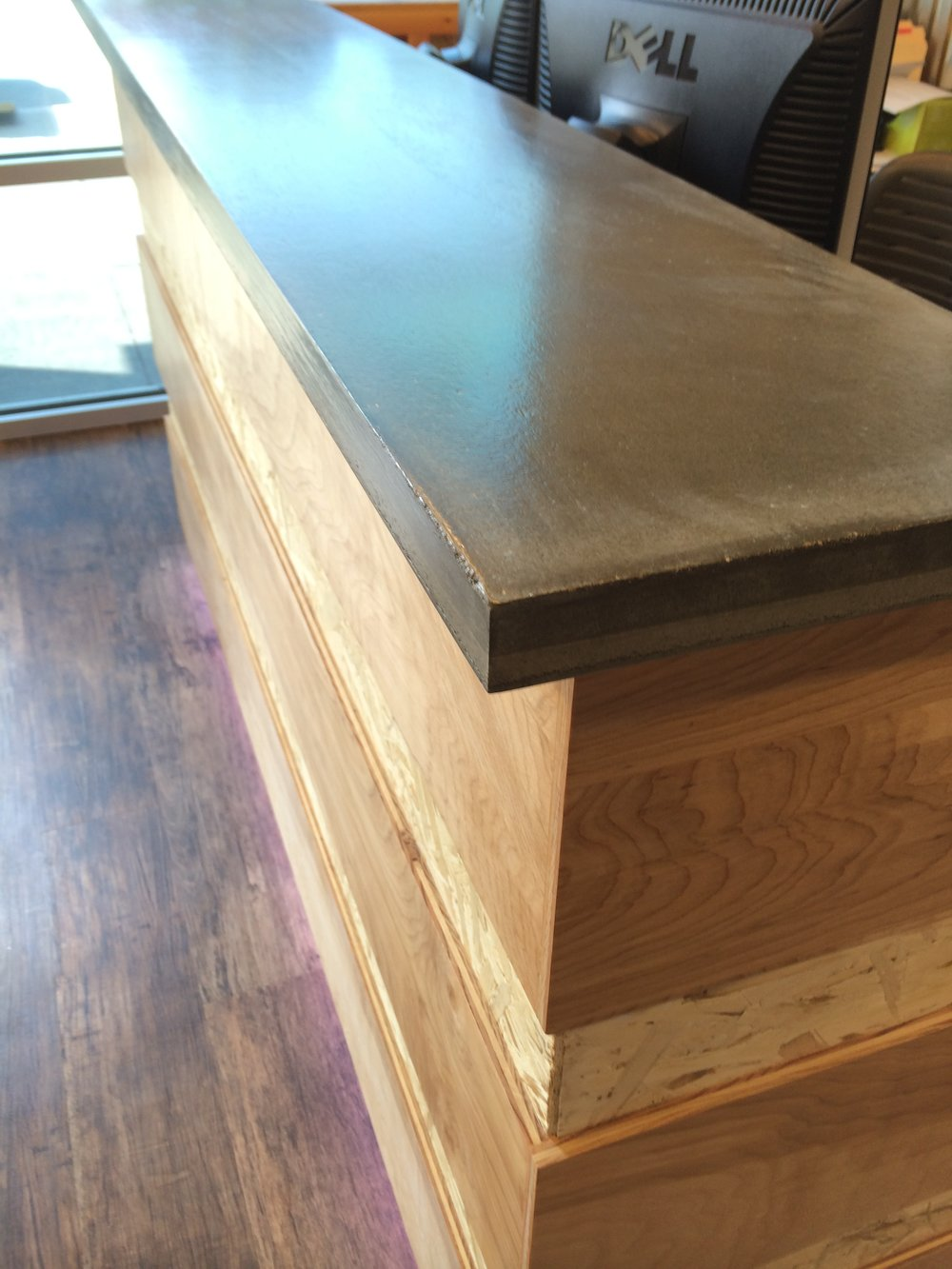 Custom cement top reception desk