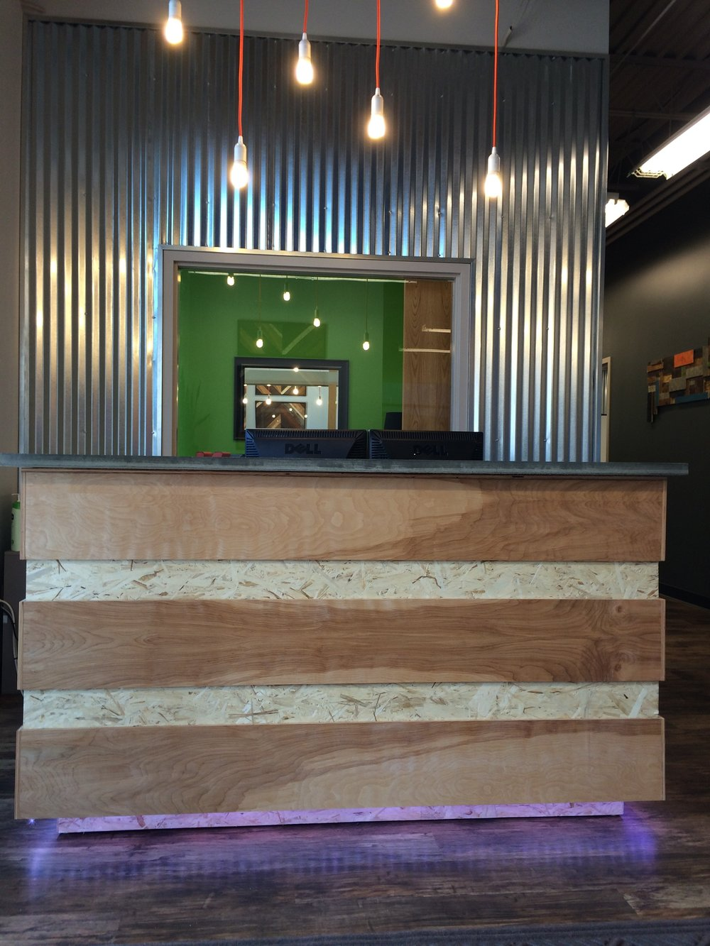 Custom birch and play wood reception desk...makes for the perfect industrial modern mix