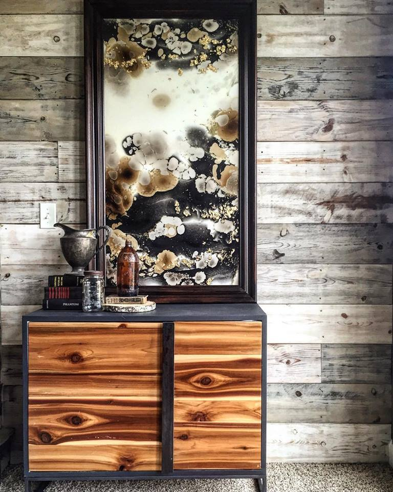 Our Ellison Cabinet with a grey body is paired with some custom artwork from Cody's personal collection for the perfect rustic modern mix.