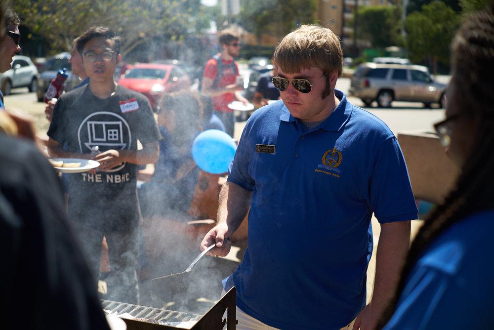Jake Trokey grills hamburgers
