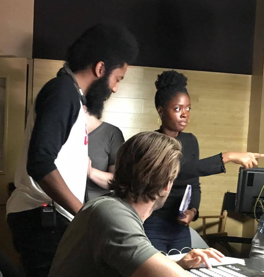 Director Terence Johnson works with fellow DKA alum Nyasha Bryant on set as Bryant, In the role of 1st AC, oversees the shoots scheduling.