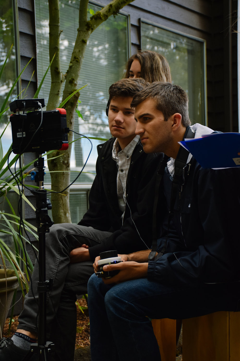 Director, Colton Van Til, sits behind monitor while one of our pledges, Zackary Rayner, pulls focus.
