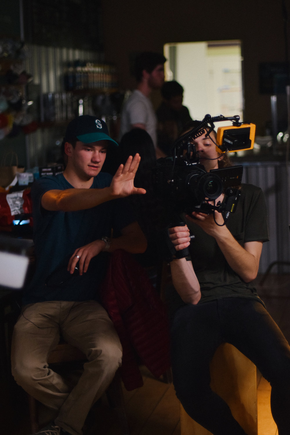 """Colton Van Til directs the camera on set of """"Aberdeen"""" while fellow LMU student, Logan Williams operates the camera."""
