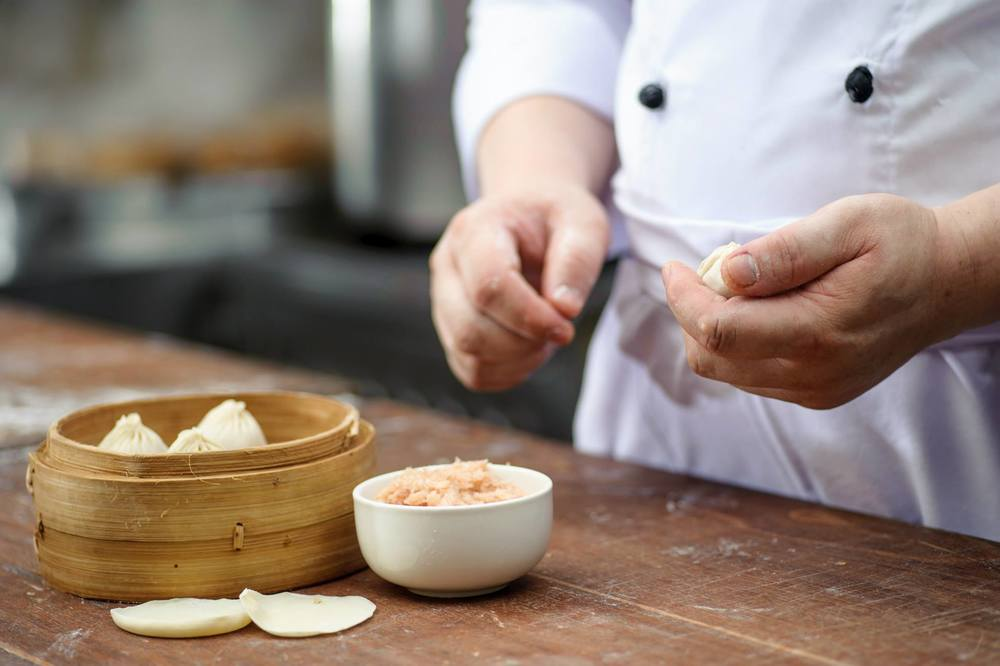 chef sealing bao.jpg