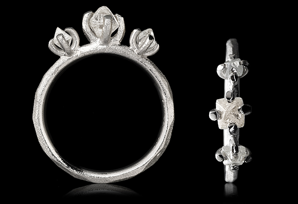 Snow White diamonds on a brushed white gold ring in 14 karat.