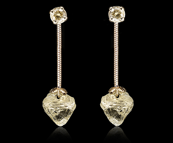 Large dangling raw diamonds hanging from green brilliant studs.