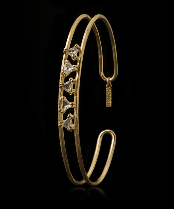 Petite triangle macles diamonds in a brushed gold bangle.