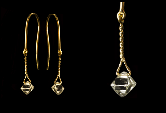 Hanging clear rough octahedron diamond earrings.